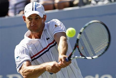 Andy Roddick of the U.S. hits a return to compatriot Rhyne Williams during their men's singles match at the U.S. Open tennis tournament in New York August 28, 2012. REUTERS/Kevin Lamarque