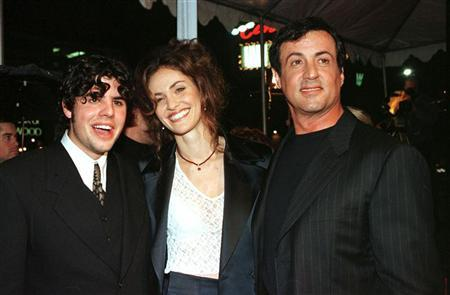 Sage Stallone, (L) appears at the premier for ''Daylight'' with Amy Brenneman and his father Sylvester Stallone (R) in Los Angeles in this December 5, 1996 file photo. Sage Stallone was found dead July 13, 2012 at his home in Hollywood, authorities and his attorney said. Police said there was no sign of forced entry or foul play. REUTERS/Fred Prouser/Files.