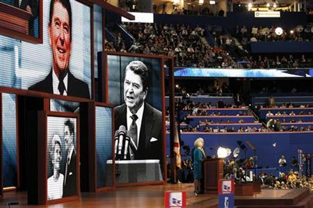 Staning in front of images of former U.S. President Ronald Reagan and former first lady Nancy Reagan, former House Speaker and former Republican presidential candidate Newt Gingrich and his wife Callista address the final session of the Republican National Convention in Tampa, Florida, August 30, 2012. REUTERS/Joe Skipper