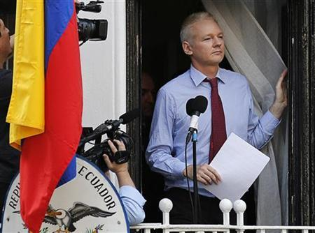 Wikileaks founder Julian Assange arrives to speak from the balcony of Ecuador's embassy, where he is taking refuge in London August 19, 2012. REUTERS/Chris Helgren