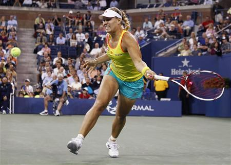 Angelique Kerber of Germany hits a return to Venus Williams of the U.S. during their match at the U.S. Open women's singles tennis tournament in New York, August 30, 2012. REUTERS/Adam Hunger