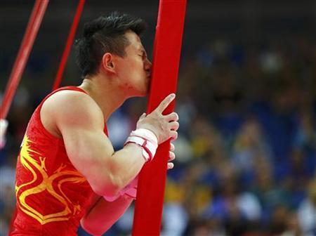 China's Chen Yibing kisses the apparatus after competing in the men's gymnastics rings final in the North Greenwich Arena during the London 2012 Olympic Games August 6, 2012. REUTERS/Mike Blake
