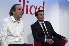 <p>Xavier Niel, fondateur d'Iliad (à gauche) et le directeur financier du groupe Thomas Reynaud. Le fournisseur d'accès à internet a conquis un million d'abonnés au deuxième trimestre avec sa nouvelle offre mobile pour s'adjuger plus de 5% du marché français en l'espace de six mois, et vise les 15% à moyen terme. Lancé le 10 janvier, le quatrième entrant sur le marché mobile a séduit 3,6 millions d'abonnés en près de six mois. /Photo prise le 8 mars 2012/REUTERS/Charles Platiau</p>