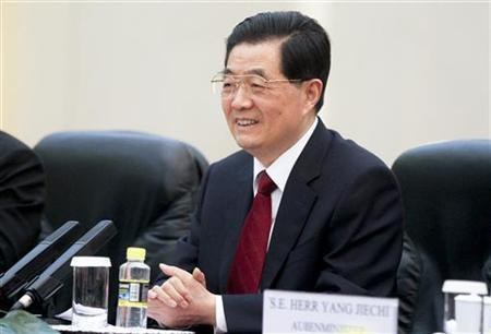 China's President Hu Jintao smiles during a meeting with German Chancellor Angela Merkel (not pictured) at the Great Hall of the People in Beijing August 30, 2012. REUTERS/Diego Azubel/Pool