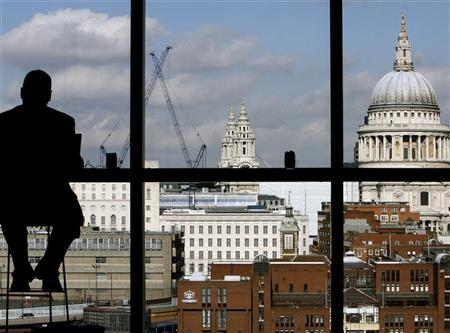 A visitor admires St.Paul's Cathedral from the restaurant floor of the Tate Modern gallery in London March 15, 2007. REUTERS/Alessia Pierdomenico