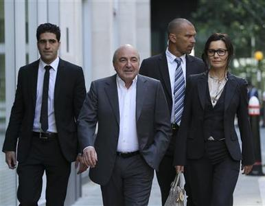 Russian oligarch Boris Berezovsky (2nd L) arrives with his partner Yelena Gorbunova (R) at a division of the High Court in London August 31, 2012. REUTERS/Olivia Harris