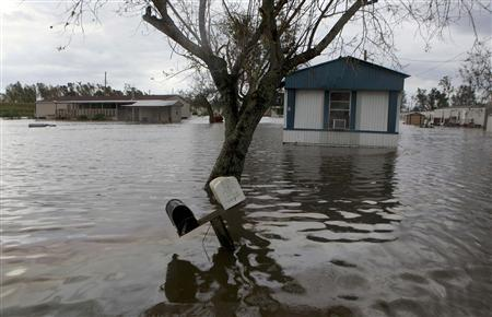 Homes are seen surrounded by water after Hurricane Isaac in Ironton, Louisiana August 30, 2012. REUTERS/Sean Gardner