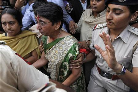 Maya Kodnani (C), a state assembly lawmaker and former Gujarat state minister, is escorted to prison by police after a court hearing in the western Indian city of Ahmedabad August 29, 2012. REUTERS/Amit Dave