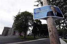 A campaign sign for Parti Quebecois legislator Stephane Bergeron is posted in the Quebec town of Varennes August 17, 2012. REUTERS/Christinne Muschi