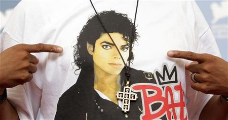 A crucifix is seen over the image of U.S. singer Michael Jackson on U.S. director Spike Lee's t-shirt as he poses during the photocall of the movie ''Bad 25'' at the 69th Venice Film Festival in Venice August 31, 2012. REUTERS/Max Rossi