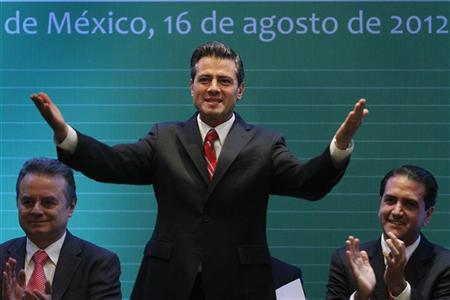 Mexico's president-elect Enrique Pena Nieto gestures during a national meeting of elected mayors from the Institutional Revoluntionary Party (PRI), in Mexico City August 16, 2012. REUTERS/Edgard Garrido