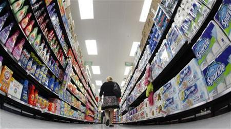 A shopper walks down an aisle in a Walmart Neighborhood Market in Chicago in this September 21, 2011 file photo. REUTERS/Jim Young/Files
