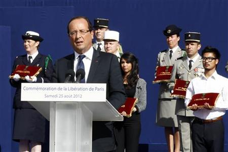 French President Francois Hollande delivers a speech during a ceremony marking the 66th anniversary of the Liberation of Paris, Agust 25, 2012. REUTERS/Jacky Naegelen/POOL