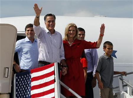 Republican presidential candidate and former Massachusetts Governor Mitt Romney, his wife Ann and other family members wave from the steps of their new campaign plane in Lakeland, Florida August 31, 2012. REUTERS/Brian Snyder