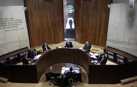 Jose Alejandro Luna Ramos (C), president of the Federal Electoral Tribunal (TRIFE), speaks as other magistrates look on during a public session in Mexico City August 31, 2012. REUTERS/Henry Romero