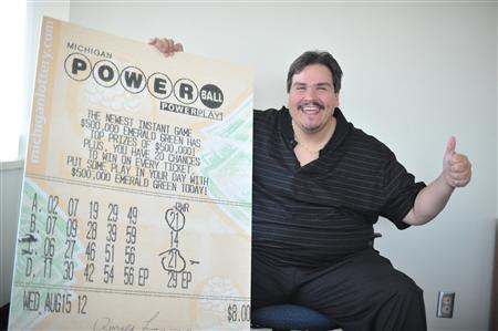 Donald Lawson poses with a copy of his winning numbers in this handout photo release by the Michigan Lottery in Lansing, Michigan August 31, 2012. REUTERS/Michigan Lottery/Handout