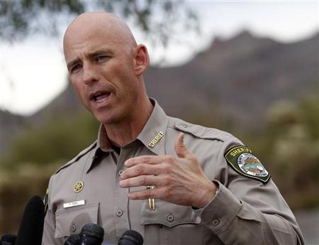 Pinal County Sheriff Paul Babeu speaks during a news conference near the Superstition Mountains where rescue workers searched for victims of a plane crashed in Apache Junction, Arizona November 24, 2011. REUTERS/Joshua Lott
