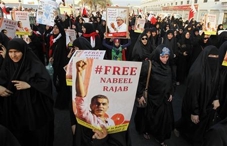Women protesters holding posters of Nabeel Rajab and Ibrahim Sharif demand for their release during an anti-government march organised by al-Wefaq opposition party in Budaiya, west of Manama, Bahrain August 31, 2012. REUTERS/Hamad I Mohammed