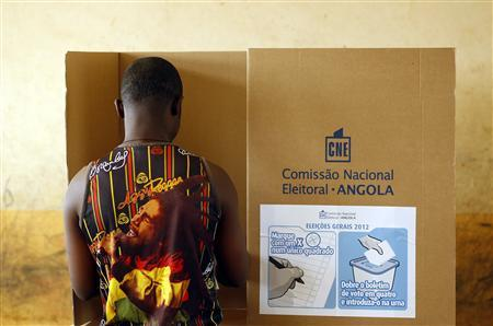 A man casts his vote at a polling station during the national elections in the capital Luanda, August 31, 2012. REUTERS/Siphiwe Sibeko