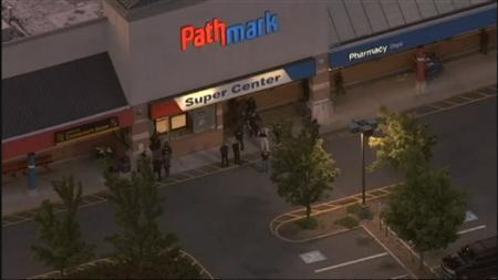 Police look over the front of a Pathmark supermarket in Old Bridge, New Jersey August 31, 2012 after a shooting incident in this still image taken from video courtesy of WNBC. The early-morning shooting left at least three dead. REUTERS/WNBC-TV/Handout