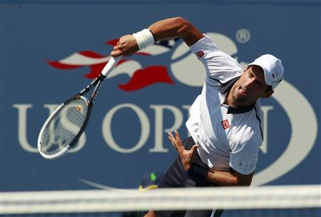 Novak Djokovic of Serbia serves to Rogerio Dutra Silva of Brazil during their men's singles match at the U.S. Open tennis tournament in New York August 31, 2012. REUTERS/Kevin Lamarque