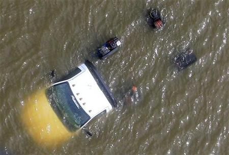 A truck is submerged in flood waters after a Hurricane Isaac levee breach in Braithwaite, Louisiana August 31, 2012. REUTERS/Sean Gardner