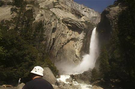 A visitor takes in the view of Upper Yosemite Falls in Yosemite National Park, California May 17, 2009. REUTERS-Robert Galbraith