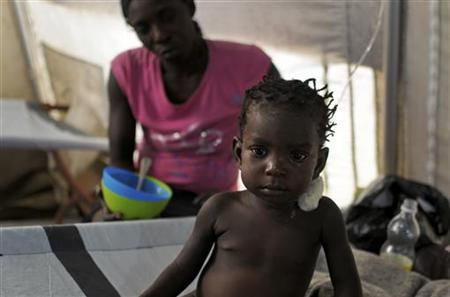 A girl receives treatment for cholera at a cholera treatment centre run by humanitarian organisation Medecins Sans Frontieres (MSF), or Doctors Without Borders, in Port-au-Prince August 31, 2012. REUTERS/Swoan Parker