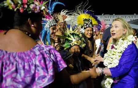 U.S. Secretary of State Hillary Clinton (R) participates in an arrival ceremony at Rarotonga International Airport in Rarotonga, August 30, 2012. REUTERS/Jim Watson/Pool