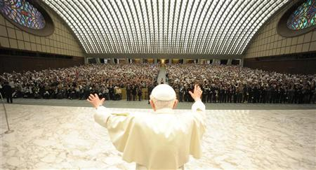 Pope Benedict XVI waves as he arrives to lead an audience in Paul VI Hall at the Vatican May 19, 2012. REUTERS/Osservatore Romano