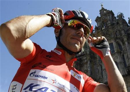 Katusha Team rider and leader of the race Joaquim ''Purito'' Rodriguez of Spain adjusts his sunglasses before the start 13th stage of the Tour of Spain ''La Vuelta'' cycling race infront the Catedral of Santiago de Compostela between Santiago de Compostela and Ferrol August 31, 2012. REUTERS/Miguel Vidal