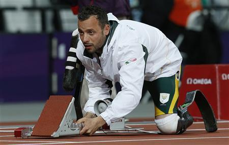 Oscar Pistorius of South Africa adjusts the starting blocks before his men's 200m T44 classification heat at the Olympic Stadium at the London 2012 Paralympic Games September 1, 2012. REUTERS/Suzanne Plunkett