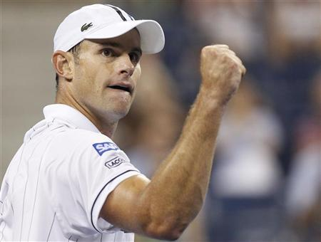 Andy Roddick of the U.S. celebrates a point in the third set against Bernard Tomic of Australia at the US Open men's singles tennis tournament in New York, August 31, 2012. REUTERS/Adam Hunger