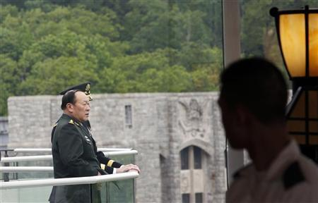 Chinese Minister of National Defense General Liang Guanglie stands on a balcony overlooking the campus of the U.S. Military Academy in West Point, New York, May 10, 2012. REUTERS/Mike Segar