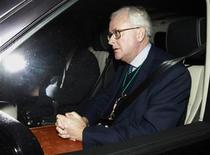 Former Chief Executive of Barclays Bank, John Varley, is driven away after a meeting with Britain's Chancellor George Osborne and Business Secretary Vince Cable, at the Treasury in London December 21, 2010. REUTERS/Andrew Winning