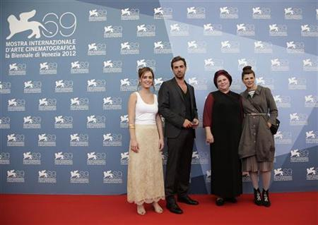 Actors Hadas Yaron (L), Yiftach Klein (2nd L) and Irit Sheleg (R) pose with director Rama Burshtein during a photocall for the movie ''Lemale Et Ha' Chalal (Fill The Void)'' at the 69th Venice Film Festival September 2, 2012. REUTERS/Tony Gentile