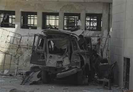 The wreckage of a vehicle is seen after an explosion near major military and security compounds in Damascus September 2, 2012, in this handout photograph released by Syria's national news agency SANA. REUTERS/SANA