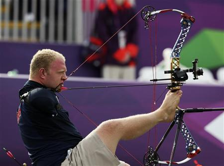 Matt Stutzman of the U.S. uses his feet to support his bow and his teeth to fire the arrow during the Archery Men's Individual Compound - Open at the London 2012 Paralympic Games August 31, 2012. REUTERS/Olivia Harris