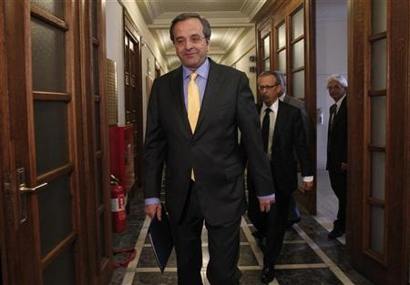 Greek Prime Minister Antonis Samaras (L) arrives for a cabinet meeting at the parliament in Athens August 31, 2012. REUTERS/John Kolesidis