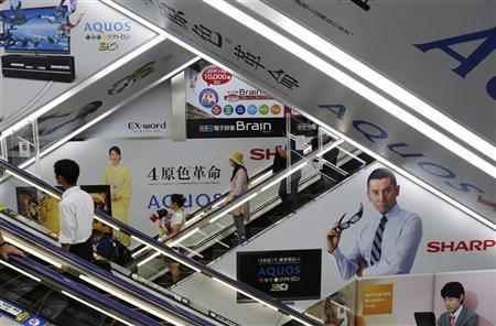 Advertisements for Sharp are seen at an electronics shop in Tokyo August 27, 2012. Hon Hai Precision Industry Chairman Terry Gou said on Monday an agreement to buy a 9.9 percent stake in Japan's Sharp Corp was unchanged ''in principle'', after Japanese media said the Taiwanese company would not seek to raise its planned ownership in the struggling TV maker. REUTERS/Kim Kyung-Hoon
