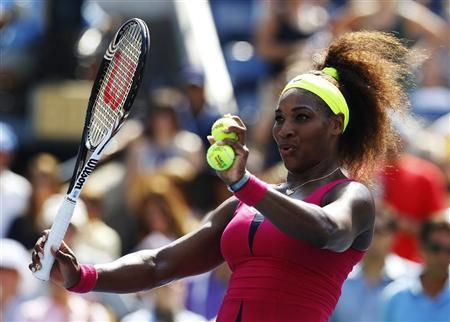 Serena Williams of the U.S. prepares to hit autographed balls into the crowd after defeating Ekaterina Makarova of Russia during their women's singles match at the U.S. Open tennis tournament in New York September 1, 2012. REUTERS/Jessica Rinaldi