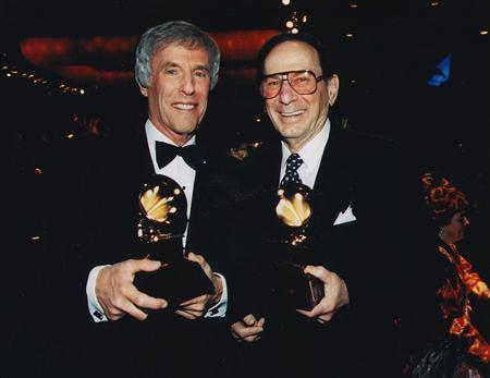 Lyricist Hal David (R) and composer Burt Bacharach pose after receiving the Grammy Trustee Award in 1997, in this undated handout photo. REUTERS/Courtesy Hal David/Library of Congress/Handout