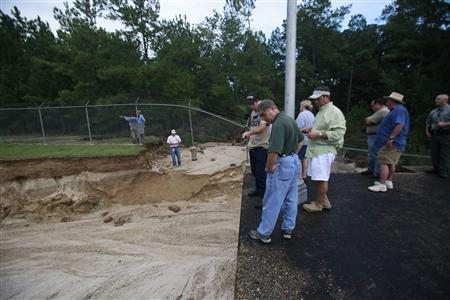 St.Tammany officials inspect lock two of the Pearl River Navigational Canal after Hurricane Isaac in Bush, Louisiana, September 1, 2012. REUTERS/Roy Snyder/St. Tammany Parish/Handout
