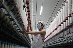 A labourer works at a textile mill in Huaibei, Anhui province, in this August 1, 2012 file picture. China's vast manufacturing sector has been badly hit by slowing new orders, a weekend survey showed, a sign that the pace of growth in the world's second-largest economy will weaken well into the third quarter. China's official factory purchasing managers' index (PMI) -- one of the early indicators of the state of the economy -- fell to a lower-than-expected 49.2 in August, the National Bureau of Statistics said September 2, 2012. REUTERS/Stringer/Files