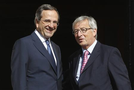 Greece's Prime Minister Antonis Samaras (L) smiles next to Luxembourg's Prime Minister and Eurogroup chairman Jean-Claude Juncker during their meeting in Athens August 22, 2012. REUTERS/John Kolesidis