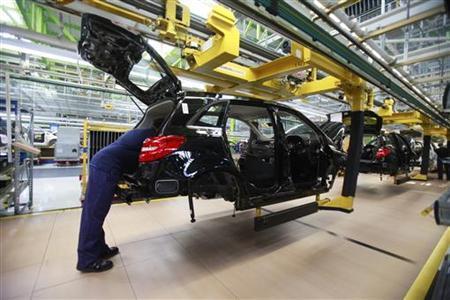An employee of German car manufacturer Mercedes Benz works on a Mercedes B-class car at the Mercedes plant in Rastatt July 16, 2012. REUTERS/Alex Domanski