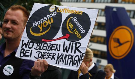 A member of German air carrier Lufthansa cabin crew union ''UFO'' holds a placard reading ''where are we going with this campaign'' as he walk towards the Lufthansa headquarters during a strike at the Fraport airport in Frankfurt, August 31, 2012. REUTERS/Kai Pfaffenbach