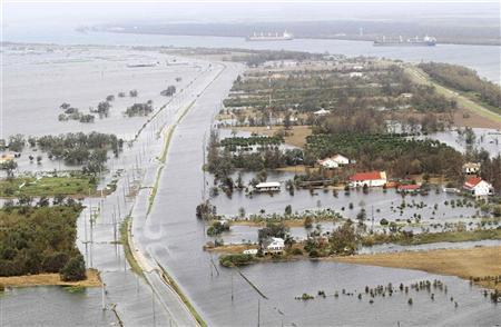 Water from the Gulf of Mexico floods Highway 23 in Hurricane Isaac-hit Plaquemines Parish, Louisiana August 31, 2012. REUTERS/Sean Gardner