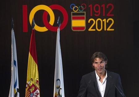 Tennis player Rafael Nadal, the official Spanish flag barrier at the London Olympics, speaks during a handover ceremony in Madrid July 14, 2012. REUTERS/Juan Medina