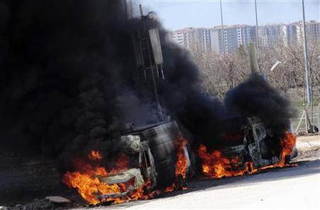 Mobile telephone relay stations are set on fire by pro-Kurdish demonstrators in Diyarbakir, southeastern Turkey, March 18, 2012. REUTERS/Stringer